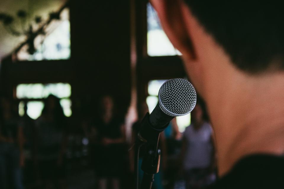 Man speaking at microphone