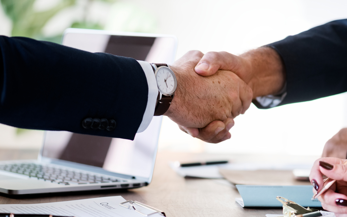 A handshake following a sale